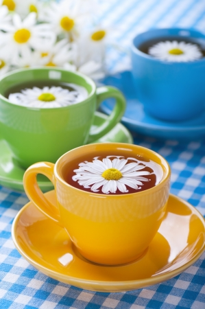 chamomile tea: Herbal chamomile tea in a yellow cup Stock Photo