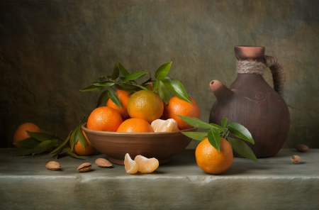 Still life with tangerines and jug photo