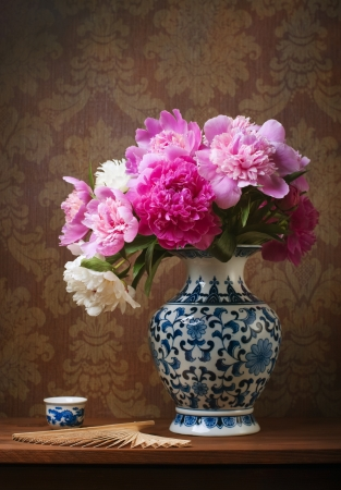 Still life with peonies in a chinese vase Stock Photo