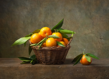 mandarin orange: Still life with tangerines in a basket on the table Stock Photo
