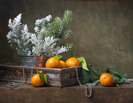 Christmas vintage still life with tangerines and  christmas decorations photo