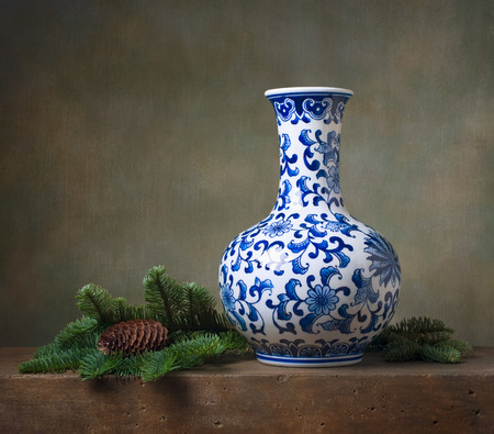 Still life with chinese vase and fir branches Stock Photo