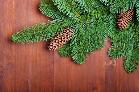 Fir branches with cones on wooden boards photo