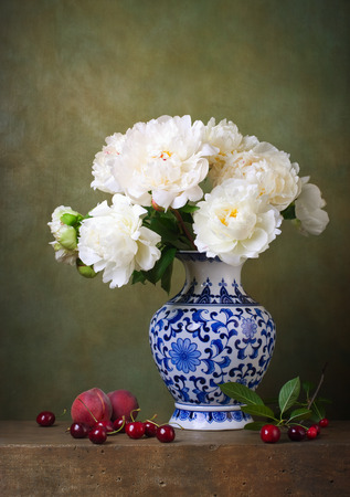 Still life with white peonies in a chinese vase photo