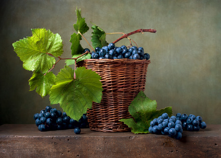 fruit basket: Still life with grapes in a basket Stock Photo