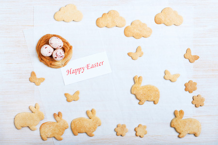 Easter cookies in the shape nest, rabbits, butterflies and clouds photo