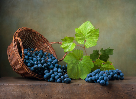 Still life with grapes on a basket Stock Photo