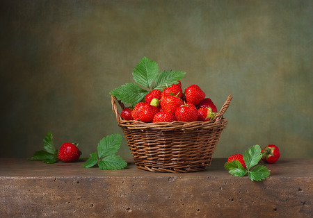strawberry baskets: Still life with strawberries in a basket