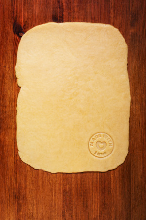 cookie sheet: Shortcrust pastry on the wooden table. Kitchen background
