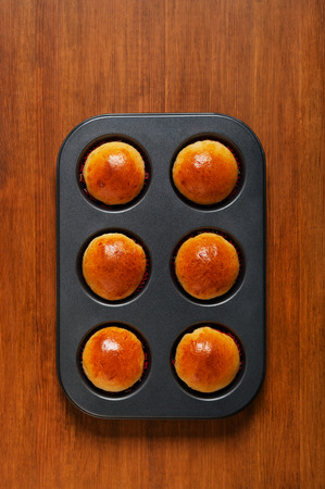 bap: Fresh buns in a baking dish on the table Stock Photo