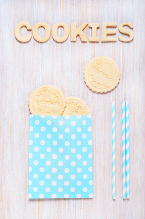 tubules: Cookies and letters of shortcrust pastry on the wooden table