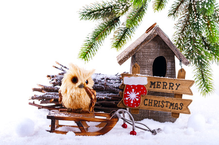 heap snow: Christmas decorations: owl, birdhouse and signboard Merry Christmas