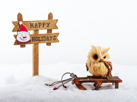 Christmas decorations: owl and signboard Happy holidays
