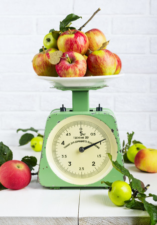 grams: Apples fruit on old vintage scale 1960. One division of 20 grams. Only for domestic use Stock Photo