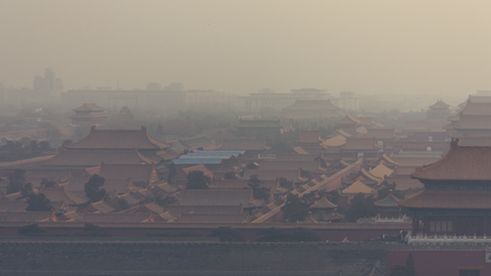 High and wide angle horizontal shot of the Forbidden City in Beijing China, on a foggy day. Archivio Fotografico