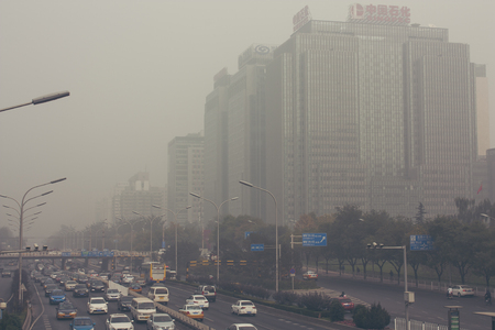 24 October,2014 - Beijing China. Air pollution in Beijing China city center,countless cars stuck on the road,the building beides are Sinopec(the China Petroleum and Chemical Corporation) and a bank Editorial