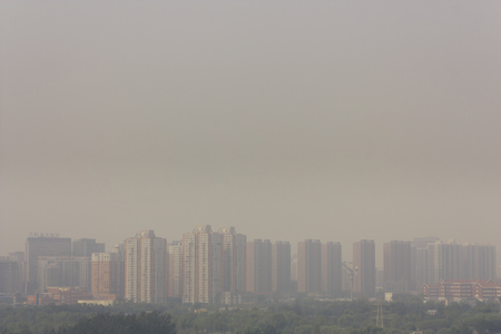 Wide angle horizontal  shot of  buildings in beijing on a foggy day Imagens