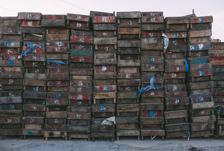 Beijing , China - Dec 21, 2014: colorful crates massive stacked on wooden pallets in a market. the pallets shown the name of owerns Stock Photo