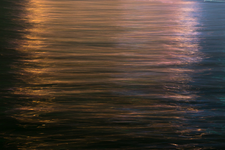 Water reflects light at night making lt like oil painting