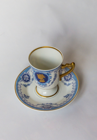 a white tea set with pattern on white background