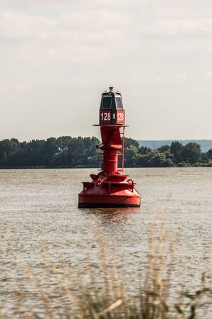 red buoy on the river elbe