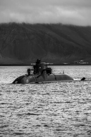 surfaced submarine in cold waters