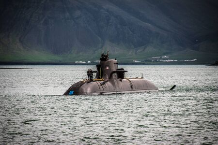 surfaced submarine in cold waters Stock Photo