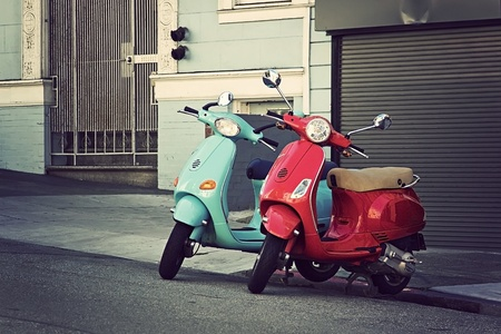 motor scooter: Two cute motorbikes parked on San Francisco street