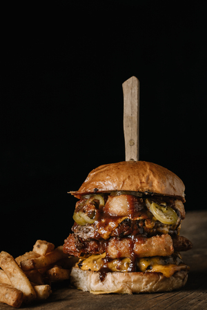 Double Meat Burger with fried onion rings, cheese and pickled jalapenos