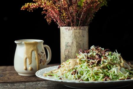 Gourmet caesar with lettuce, shredded parmesan, toasted pecans and mustard vinaigrette