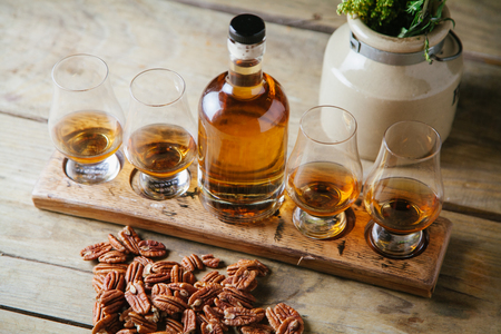 Whiskey flight on rustic wooden surface