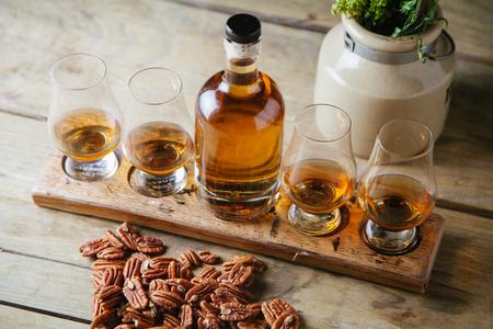 Whiskey flight on rustic wooden surface Reklamní fotografie - 88427584