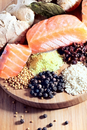 frozen salmon slices served with ginger and a variety of organic spices on a chopping board  Stock Photo - 16293227