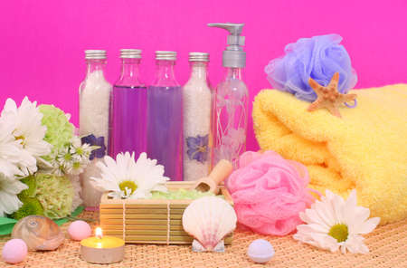 Bath and Spa Products with flowers on Pink Background