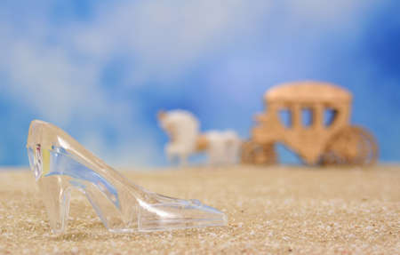 Glass Slipper on Beach With Carriage in Background, Shallow DOF Stock Photo