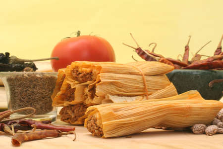 Tamales With Red Peppers and Pinto Beans on Yellow Background