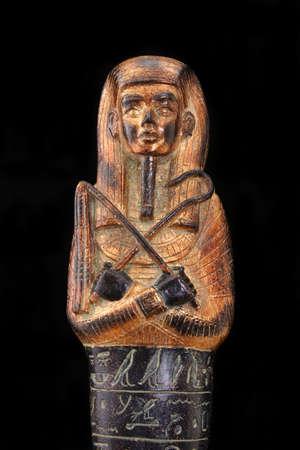 Egyptian Pharoh Statue with Hieroglyphics on Black Background
