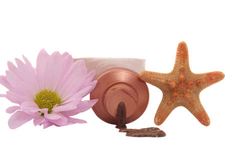 Tanning Lotion with Starfish and Pink Flower on White Background Stock Photo