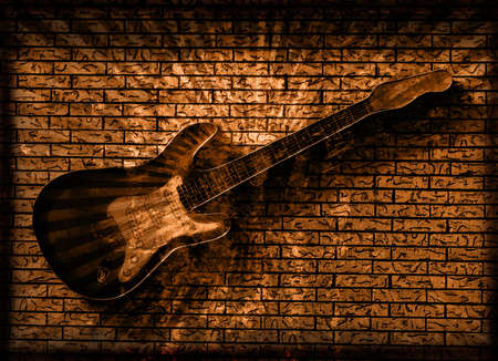 Vintage Grunge Style Background With Guitar on Brick Wall Stock Photo