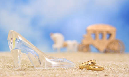 Glass Slipper with  Rings on Beach Stock Photo