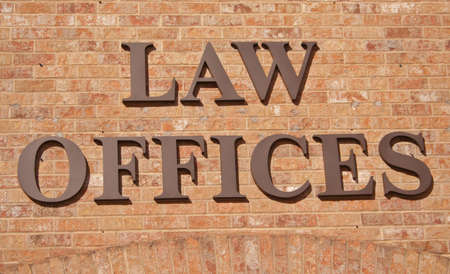 Law Offices Sign on Brick Wall