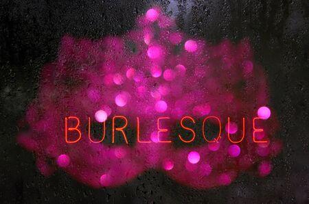 Vintage Neon Burlesque Sign in Rainy WIndow Banque d'images