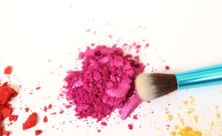 Broken Cosmetic Pigments on White Background