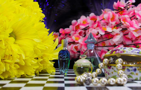 Yellow Flowers With Perfume and Jewelry