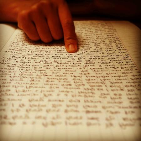nepali: Focus on reading with finger has written manuscript text nepali
