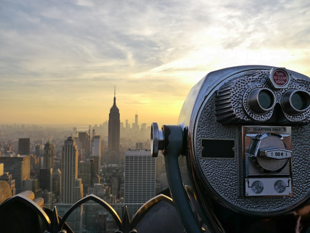looking at viewer: Tower viewer telescope binoculars over looking the New York City skyline Stock Photo