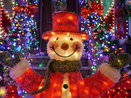 holiday lights display: Christmas outdoor Christmas decorations - Snowman lights up house Stock Photo