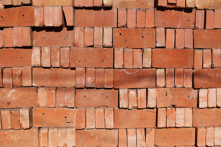 A organized pile of loose red bricks stacked on top of each other Stock Photo - 57038665