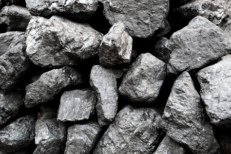 electricity export: A pile of black coal rocks stacked on top of each other