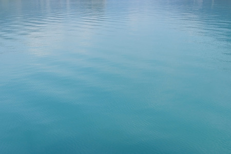 turquoise water: Clean and clear turquoise water in a lake in Switzerland Stock Photo